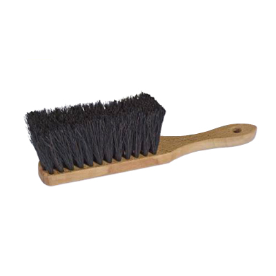 Sweeping brush for a dust pan